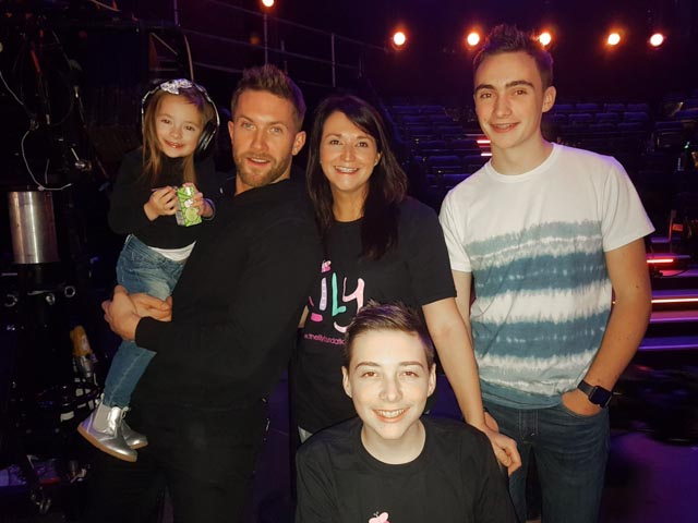 Timothy (pictured front), with contestant Matt Linnen (left), Amelia, mum Alison and brother Christopher