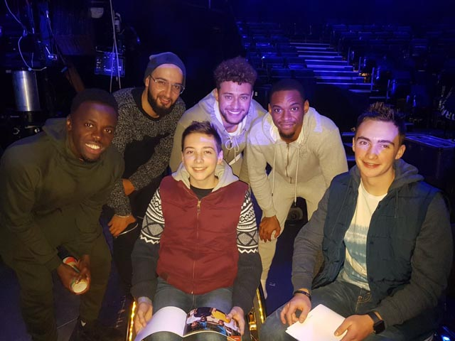 Timothy (pictured centre) and Christopher (right) with X Factor finalists Rak-Su
