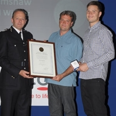 Bravery awards for father and son who caught robber