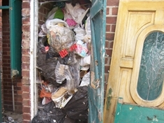 Woman fined over mountain of waste in garden