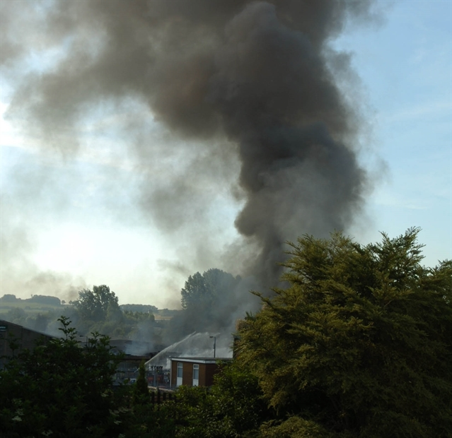 Tyre fire battle continuing