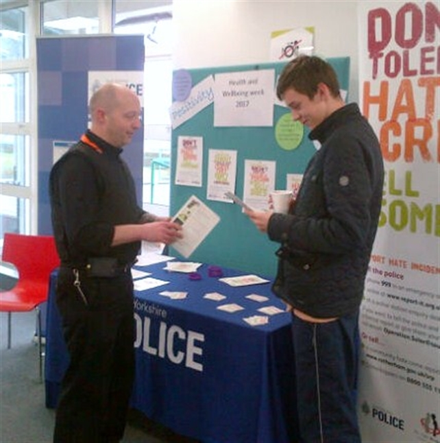 Police volunteers talk hate crime with students