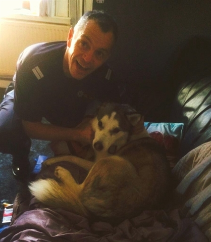 Trapped husky rescued by firefighters