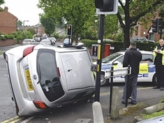 Long delays after Swinton crash leaves car on its side