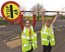 School lollipop lady saved by parents and businesses