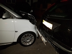 Suspected drink-driver held after crashing into parked cars
