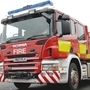 Arsonists torch tyres and roadworks sign
