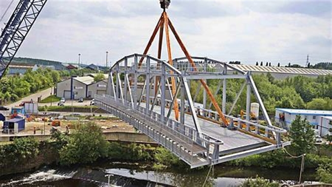 153-tonne Rotherham bridge lifted into place
