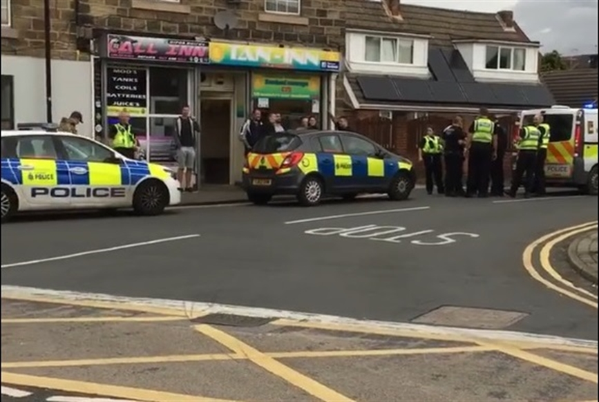 Police swoop on wanted man on busy Swinton street