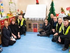 Company builds Christmas cottage for Bluebell Wood children