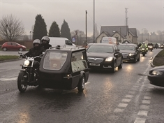 Bikers unite to give one of their own a fitting send-off