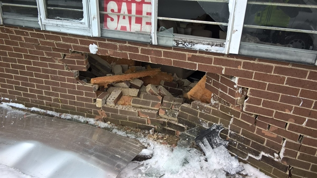 SNOW: Car crashes into shop wall in Eastwood