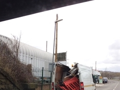 Driver rues taking on low bridge in Kilnhurst as van roof is torn off