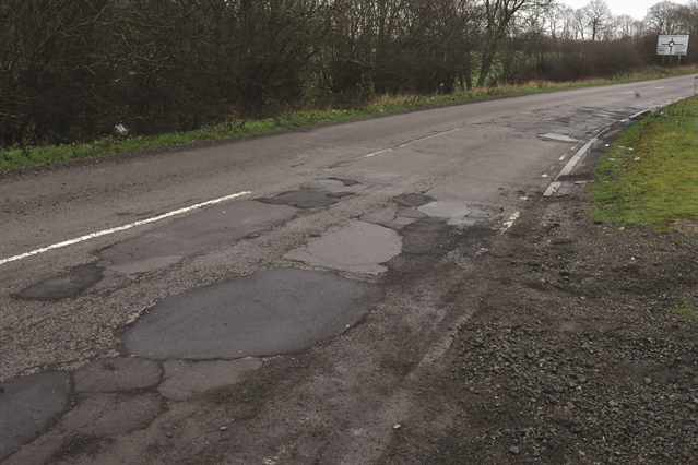 Roads crisis: Chris Grayling ploughs £100m into fixing potholes