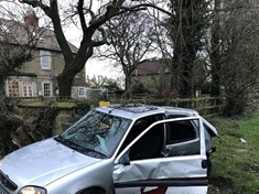 Dangerous driver crashes into village sign