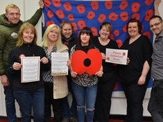 Knitted needers to back Rotherham Market poppy cascade