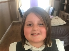 Little Evie's haircut to help young cancer patients