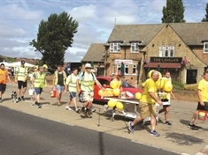 Charity bed push raises money for flying docs