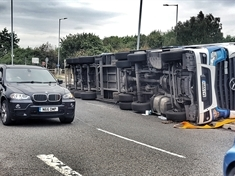 Man taken to hospital after lorry overturns at roundabout