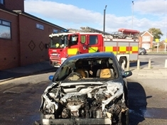 Driver and passengers escape unharmed from burning car