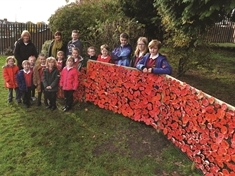 Thurcroft children unveil poppy tribute
