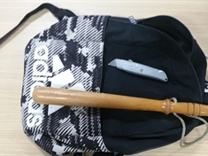 Stray schoolbag contained truncheon and knife