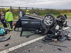 Two cars overturn in M1 smash - but those inside suffer only 'minor injuries'