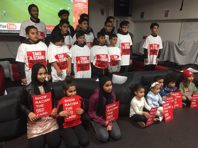 Police officers join Millers to show racism the red card