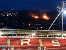 PICTURES: Grassland blaze seen from New York Stadium