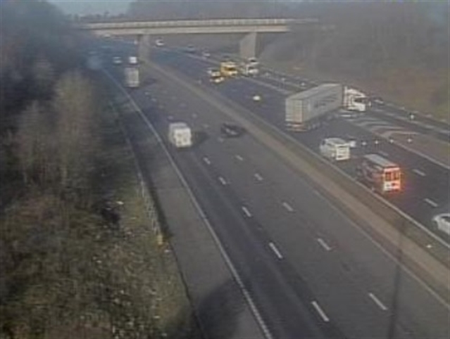 Driver fighting for life in hospital as M1 reopens