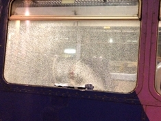 Train window smashed by brick at Holmes junction