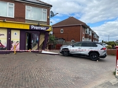 Woman injured after car hits Swinton shop