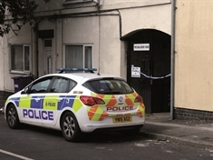 Two men held on suspicion of murder after woman's death