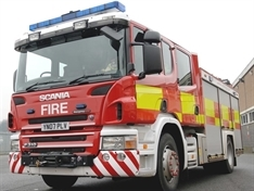 Fire crews called after car hits garden wall