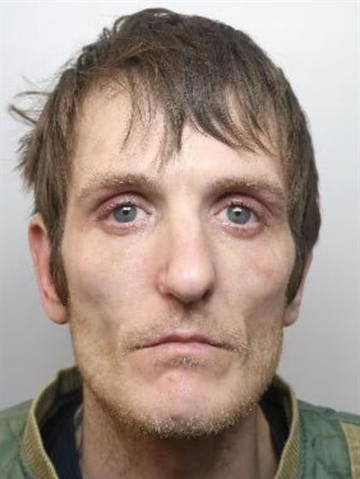 Robber who threatened frightened shop staff with dirty needle is jailed