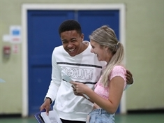 All smiles! GCSE students get deserved grades 'first-time around'