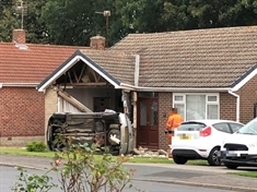 Driver flees after crashing into house