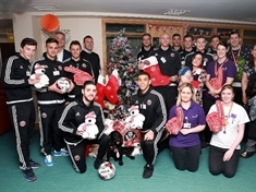 Football stars visit hospice to spread Christmas cheer